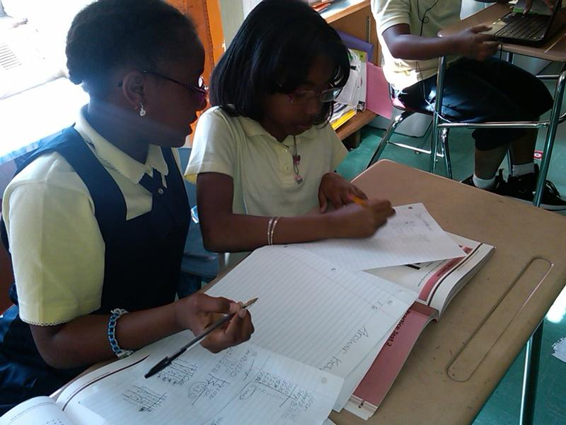 Fourth graders Jelaya Johnson and Jada Beatty-Bass practice for the state math test